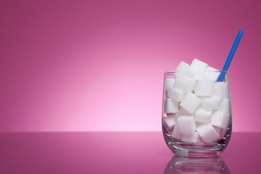"alt=""Glass filled with sugar cubes"""